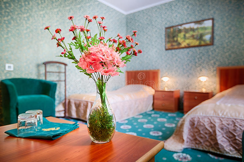 Bouquet of flowers on the table in hotel room. royalty free stock photos