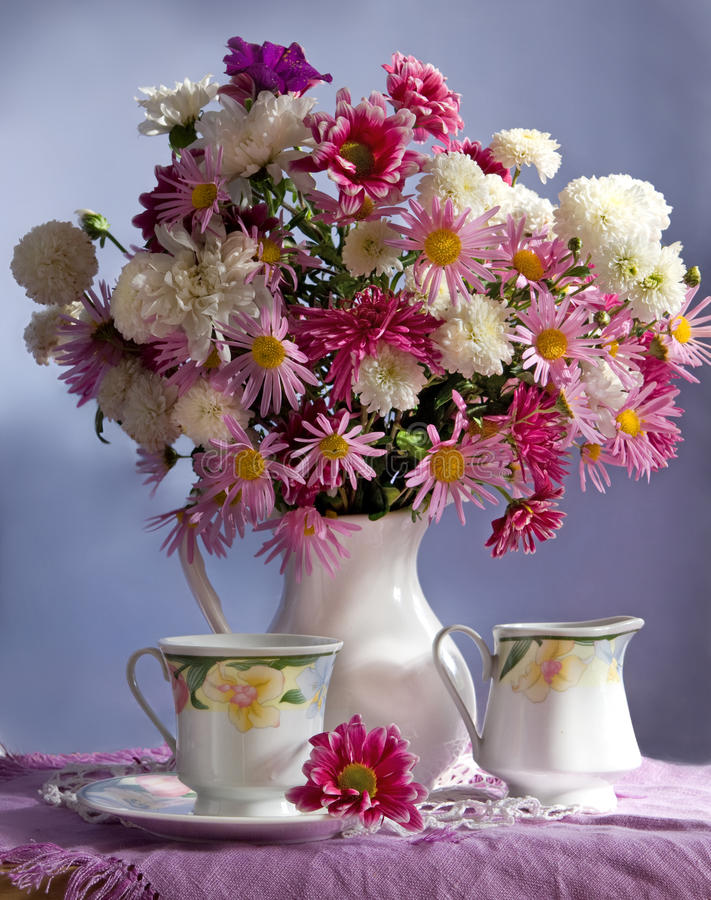 Bouquet of flowers and tea royalty free stock photo