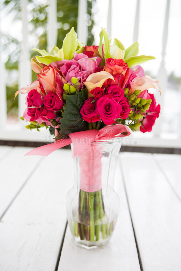 Bouquet of flowers in vase stock photography