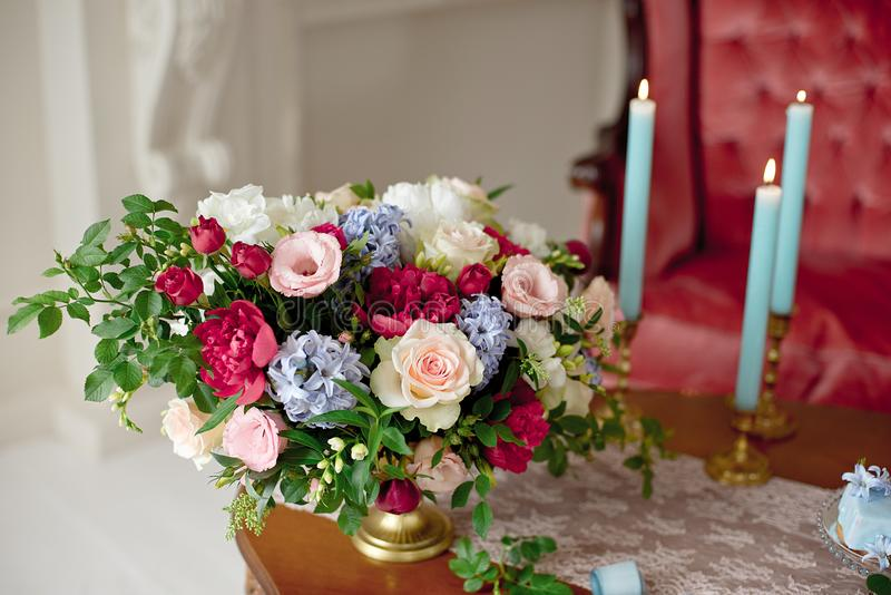 Bouquet of flowers on vintage table royalty free stock image