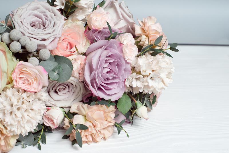 A bouquet of flowers on a wooden brown background. Copy space stock images