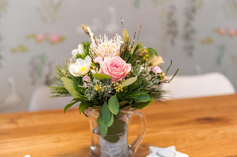 Bouquet of flowers on wooden table royalty free stock image
