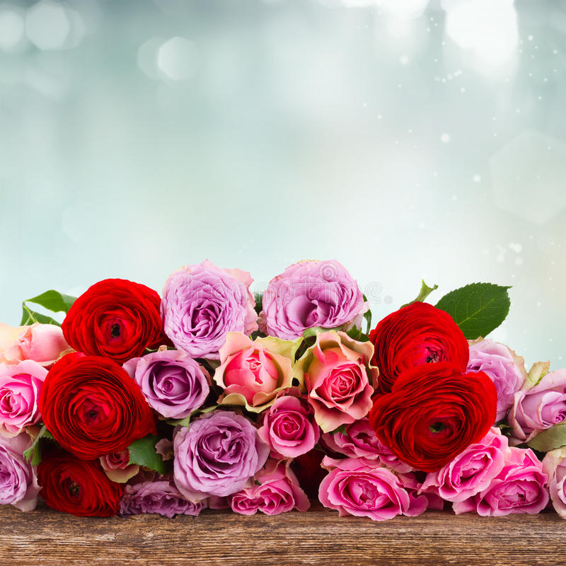 Bouquet of fresh roses and ranunculus stock photography
