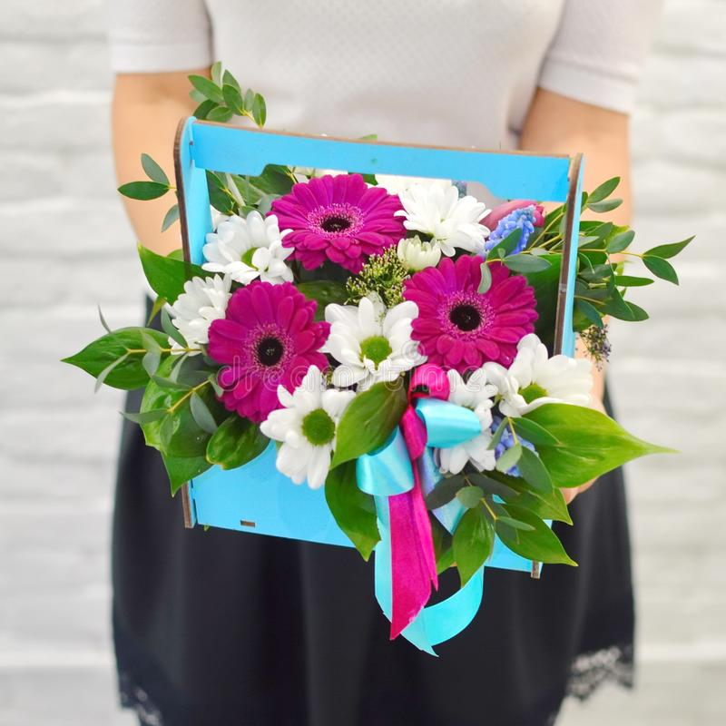 Bouquet of gentle flowers in blue woodwn box stock image