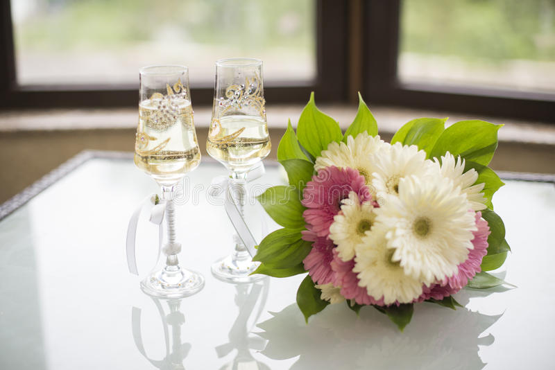 Bouquet and glass of champagne royalty free stock photos