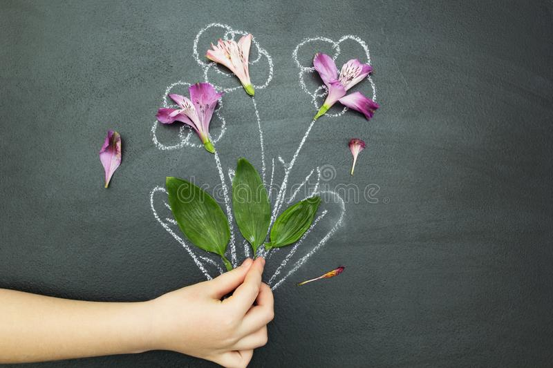 Bouquet in hand on a black background royalty free illustration