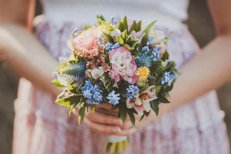 The bouquet in hand stock photo