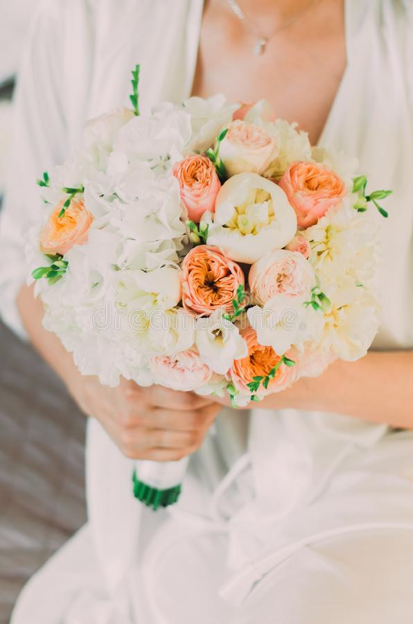 Bouquet in the hands of the bride stock photography