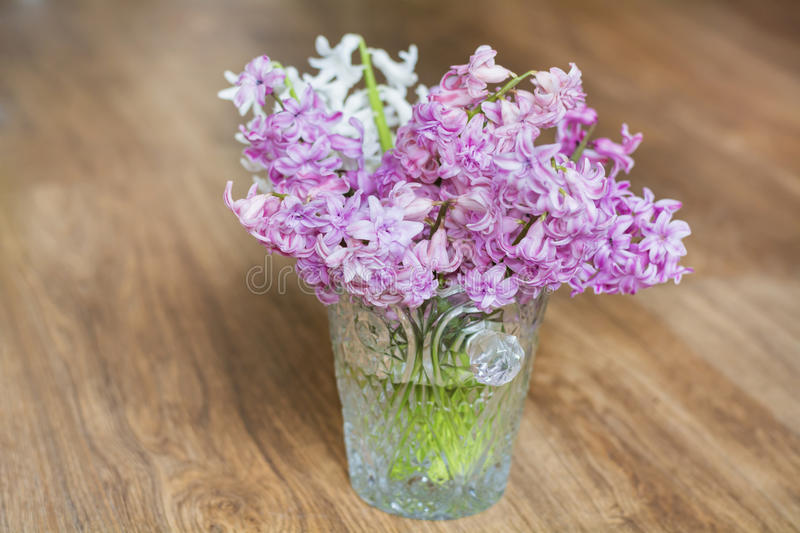 Bouquet of hyacinths flowers in a crystal vase.Spring flowers royalty free stock photos