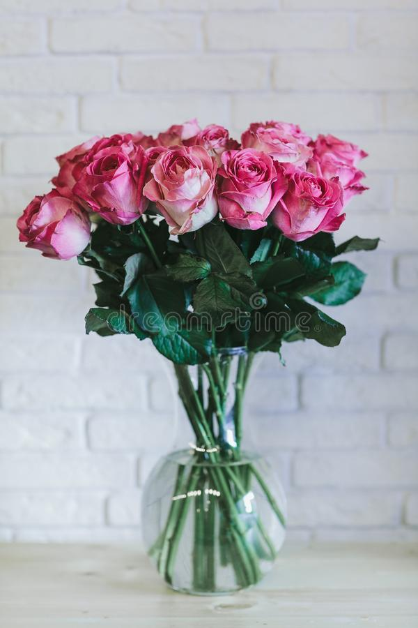 A bouquet of large pink roses close up stock photos