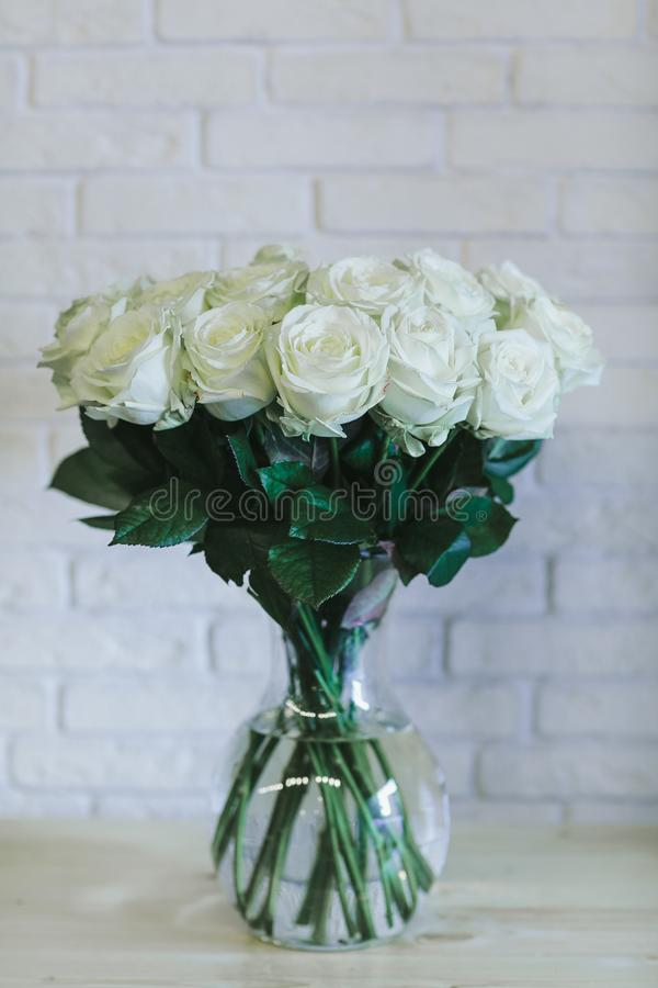 A bouquet of large white roses close up royalty free stock image