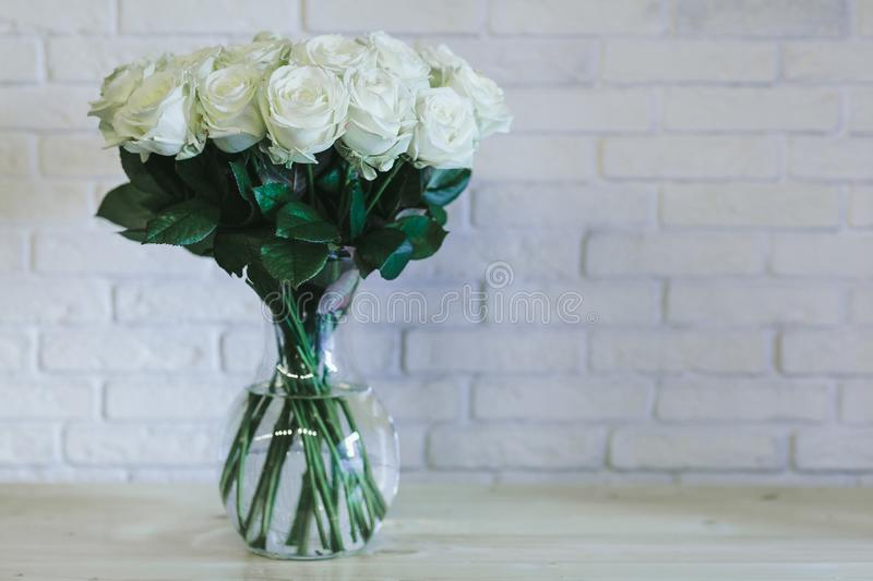 A bouquet of large white roses close up stock images