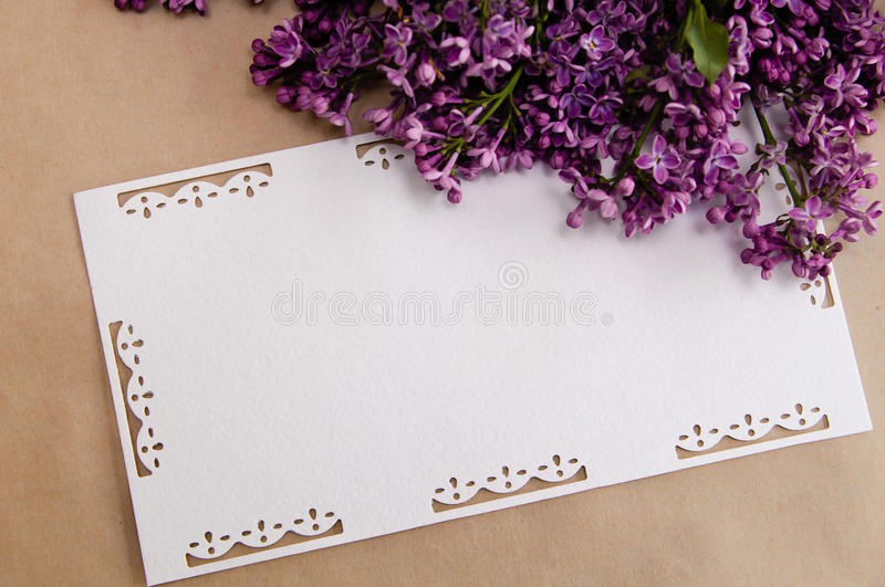 Bouquet of lilacs with an inscription card stock image