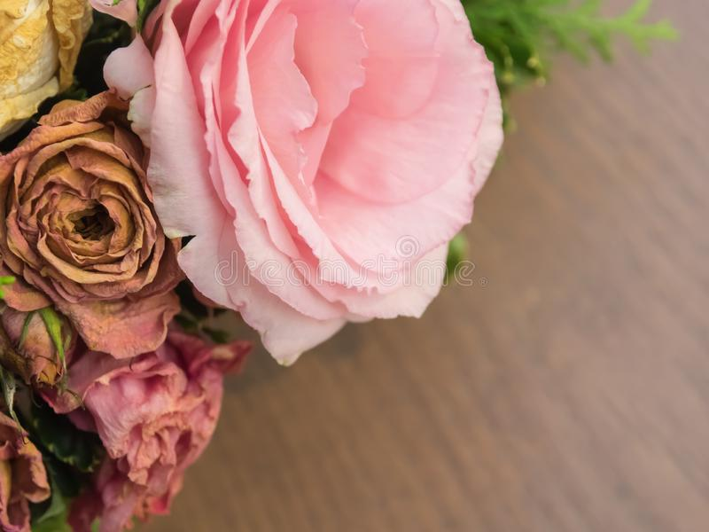 Bouquet of mixed flowers on wood background, Roses, Carnation, Eustoma, dry flowers stock image