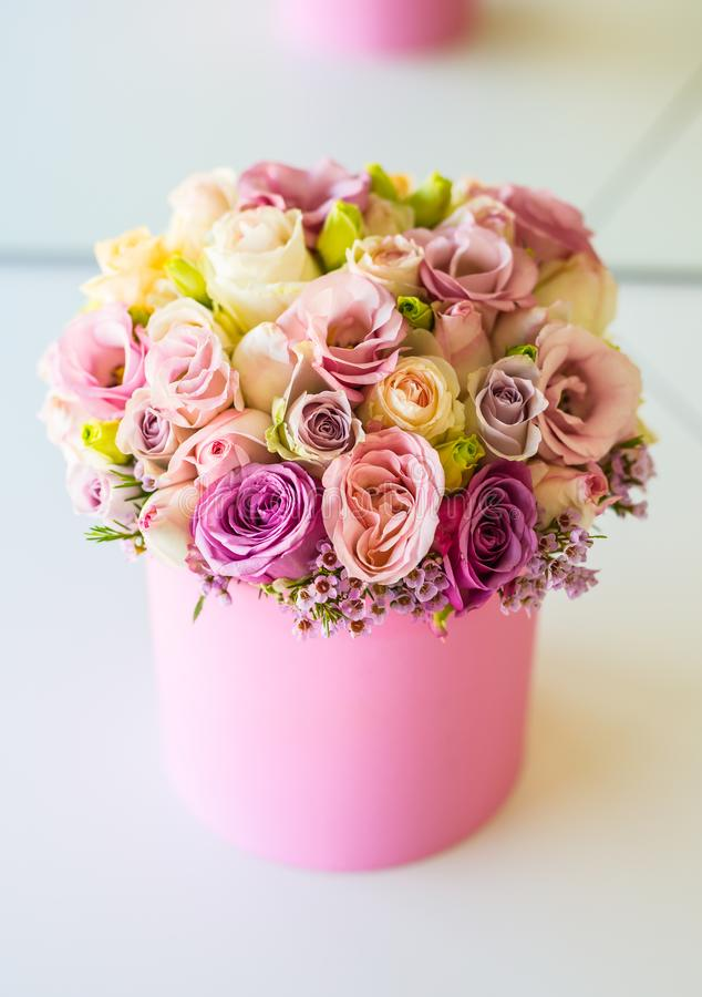 Bouquet of multicolored flowers roses in luxury gift box.  stock photos