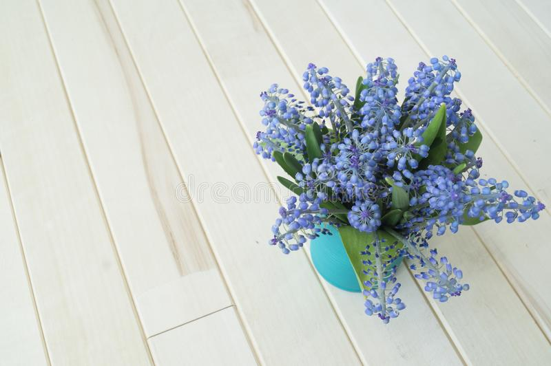 A bouquet of Muscari. Wooden background. The view from the top. stock images
