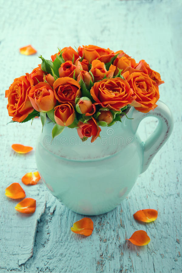 Free Bouquet Of Orange Roses In A Blue Vase Stock Photography - 30508082