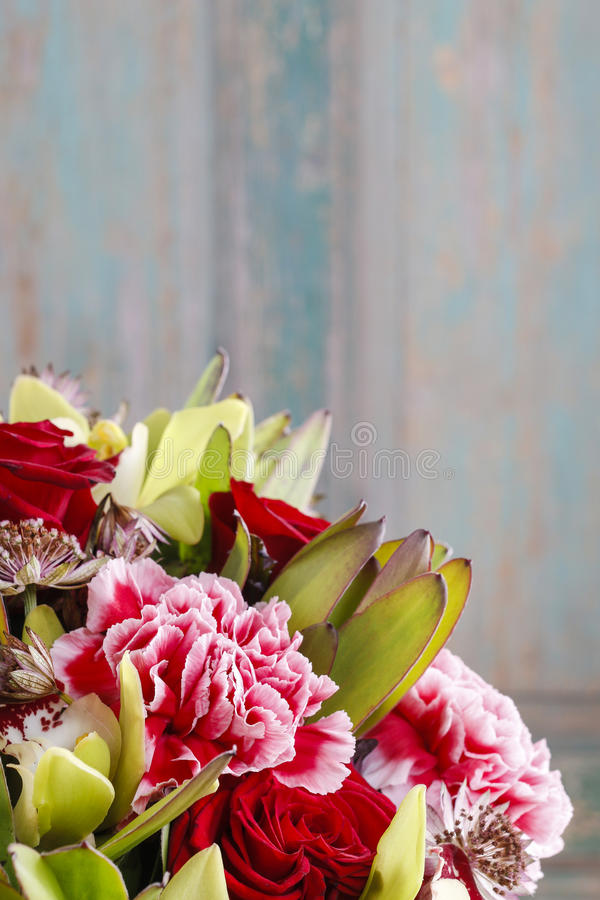 Bouquet of orchid, rose and carnation flowers. Party decoration royalty free stock images
