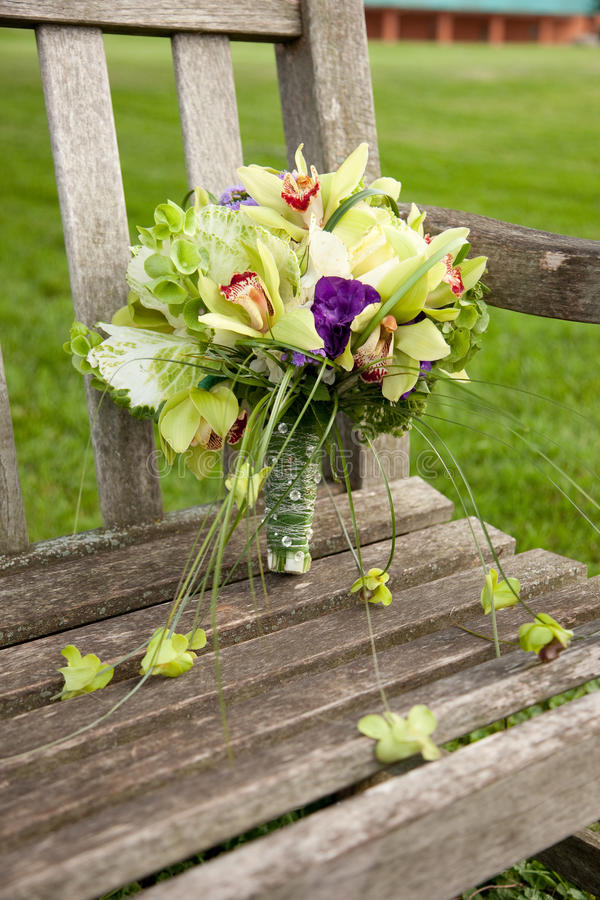 Bouquet on park bench stock photography