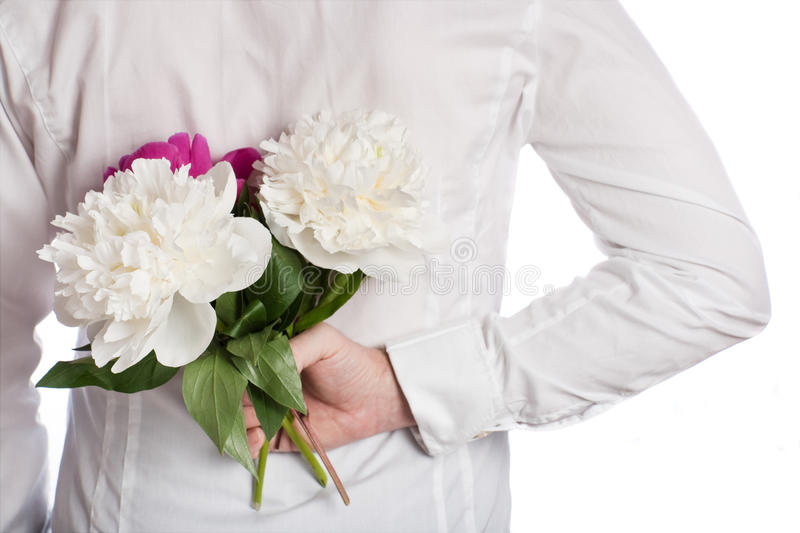 Download Bouquet Of Peonies Behind The Back Of The Man Stock Photo - Image: 15003540