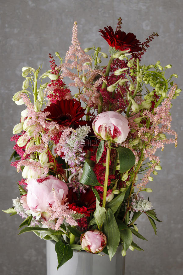 Bouquet with peonies and gerbera flowers. Party decor royalty free stock image