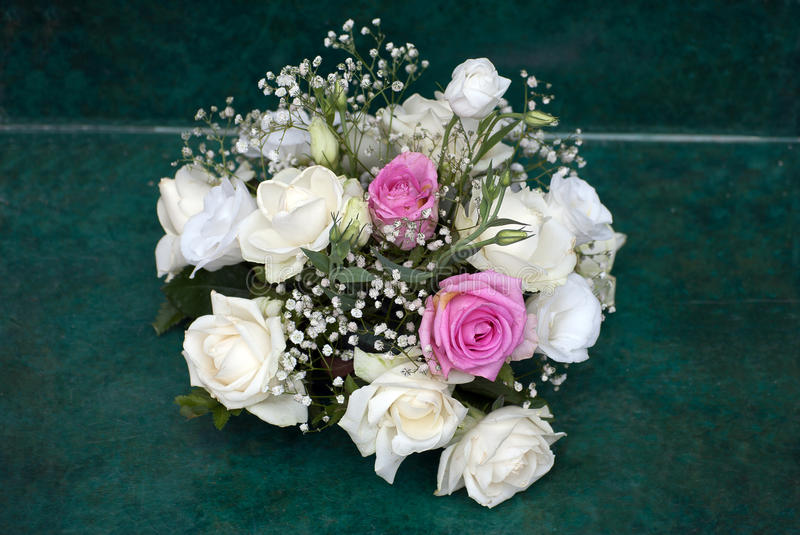 Bouquet pf flowers. Flower bouquet composed of white roses royalty free stock photo
