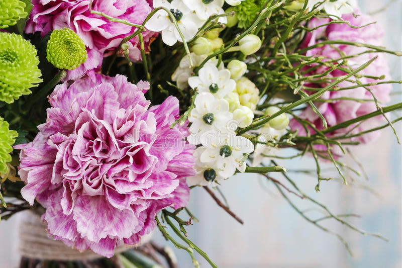 Bouquet of pink carnation, arabian star flower (ornithogalum ara. Bicum) and green chrysanthemums. Party decoration stock photos