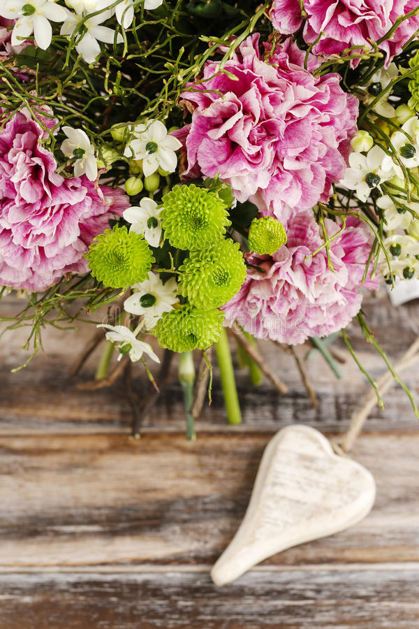 Bouquet of pink carnation, arabian star and green chrysanthemums. Bouquet of pink carnation, arabian star flower (ornithogalum arabicum) and green chrysanthemums royalty free stock photos