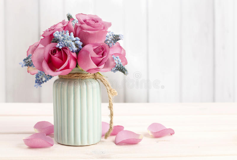 Bouquet of pink roses and blue muscari flower (Grape Hyacinth) royalty free stock photography