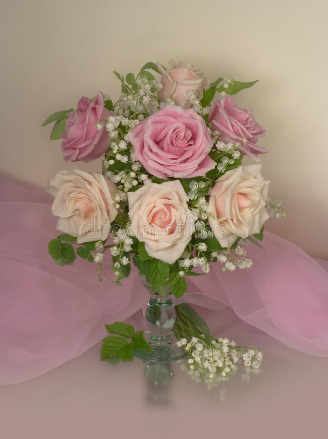 Bouquet of pink roses with lilies of the valley stock image