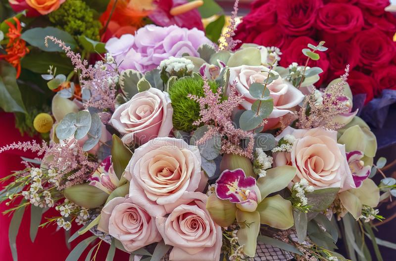 Bouquet of pink roses and other flowers stock photo