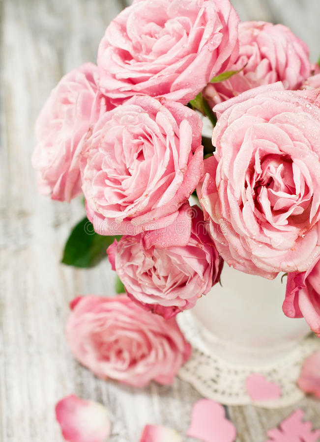 Bouquet of pink roses in a vase close-up royalty free stock photo