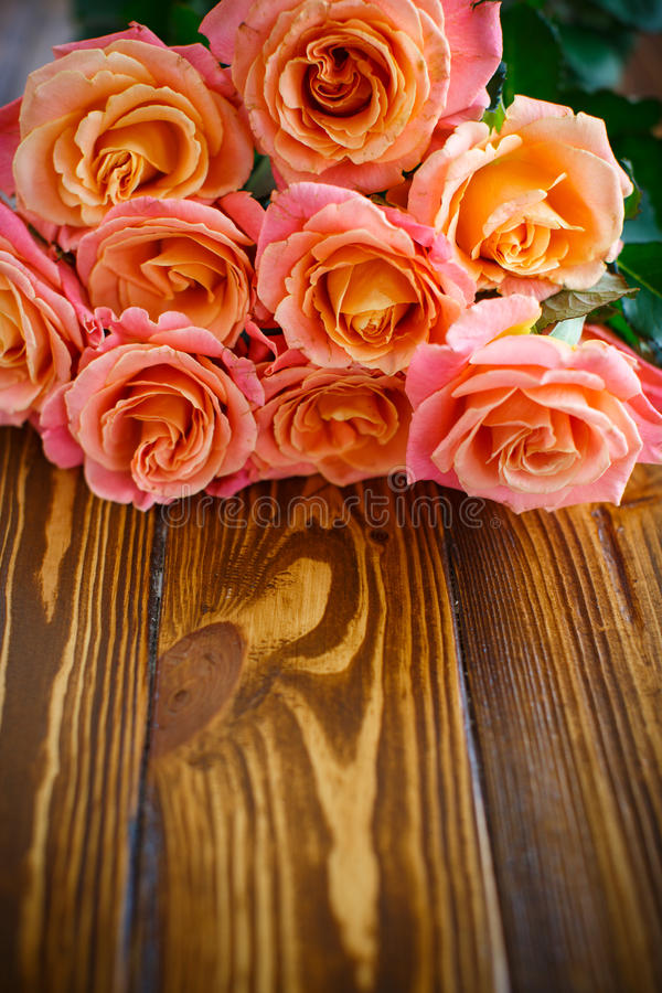 Bouquet of pink roses. On a wooden table royalty free stock photos