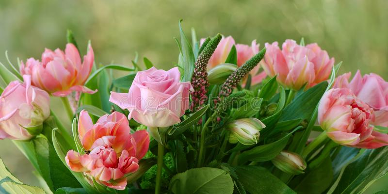 Bouquet of pink spring and summer flowers stock photo