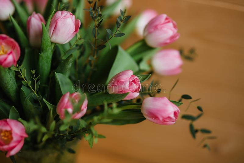 A Bouquet Of Pink Tulips In A Beautiful Crystal Vase Stock Image
