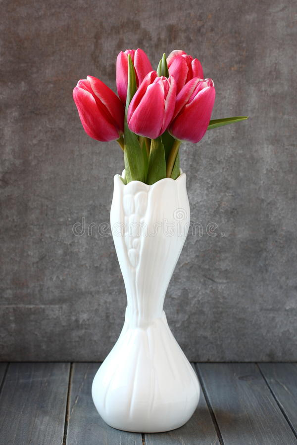 Bouquet Of Pink Tulips In White Vase On Wooden Background Royalty Free Stock Photography