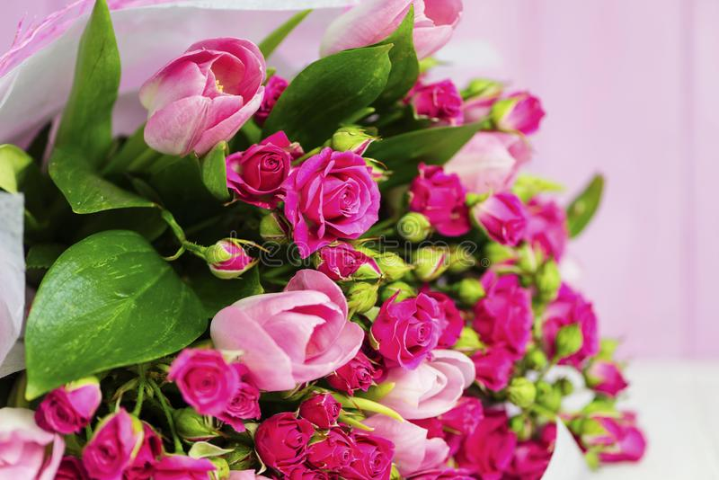 Bouquet of pink wild rose and pink tulip stock image