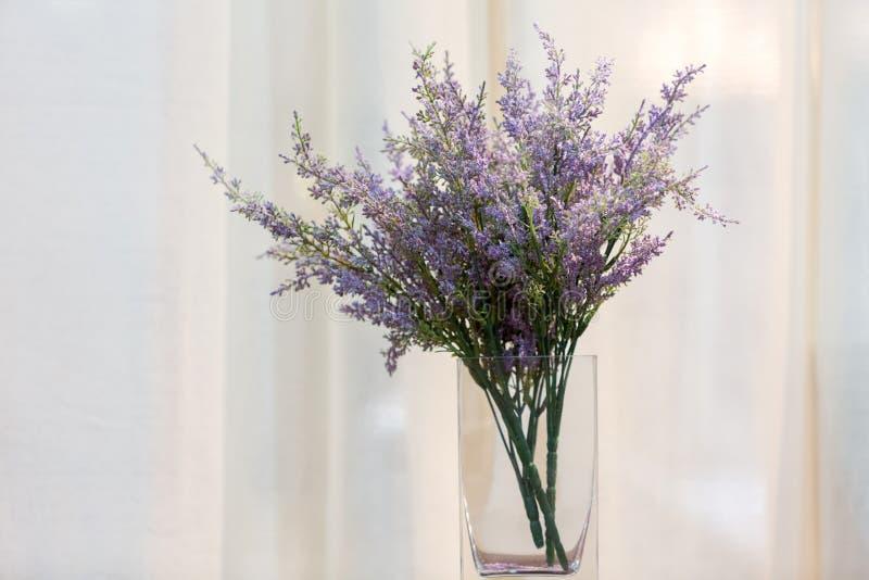 Bouquet of purple plastic flower royalty free stock photo