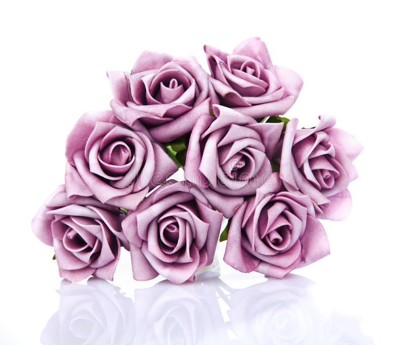 Artificial Bouquet Of Purple Roses On A White Background