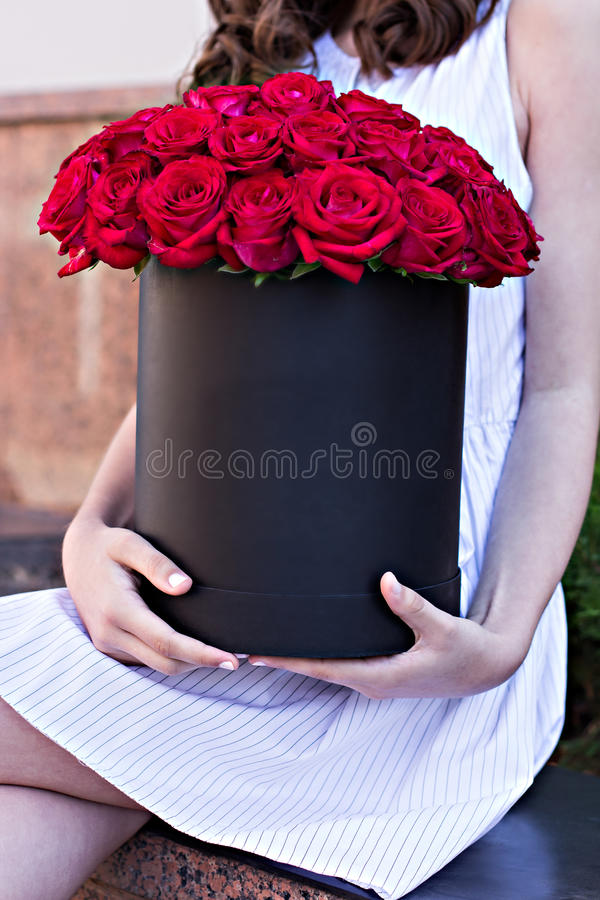 Bouquet of red roses in a box royalty free stock images