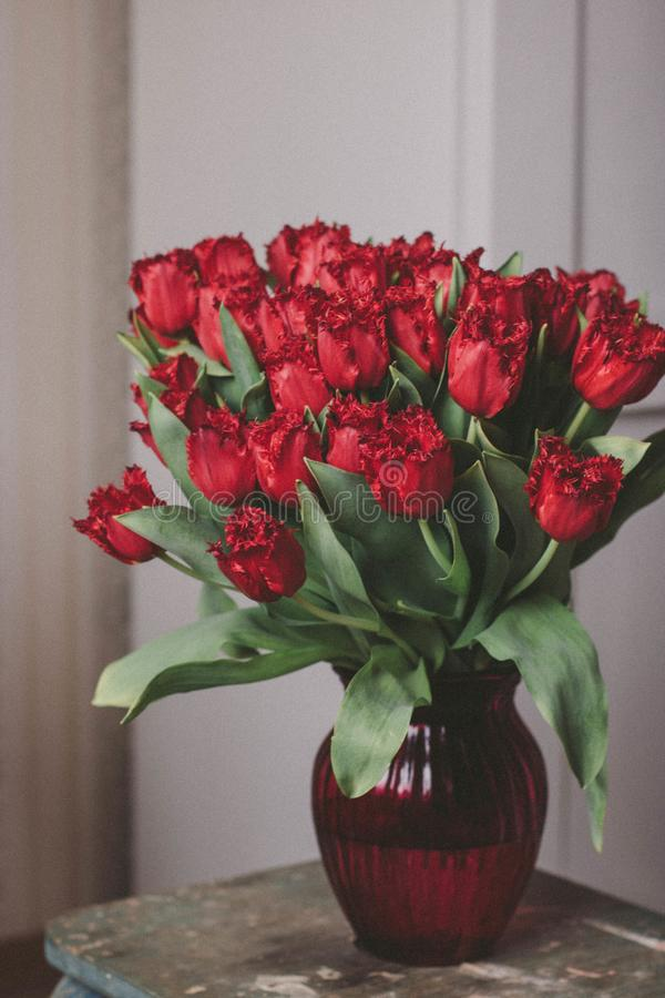 Bouquet of Red Roses on Glass Vase royalty free stock photos
