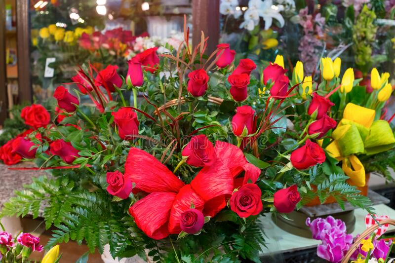Bouquet of red roses and other flowers in flower shop.  stock photography