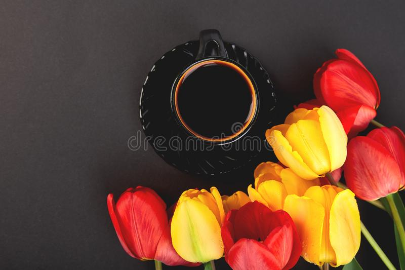Bouquet red tulips and cup of coffee royalty free stock photo