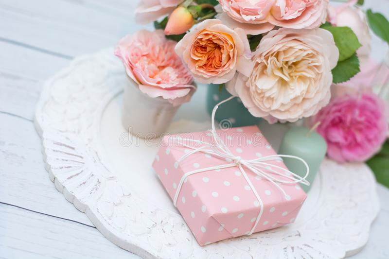 Bouquet of roses and gift royalty free stock photo