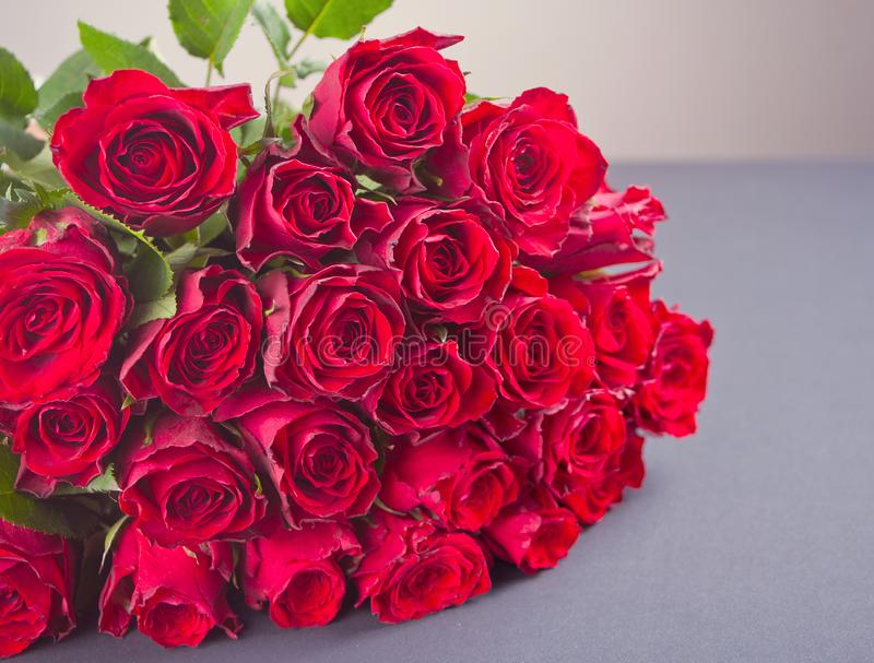 A bouquet of roses on the grey table stock photos