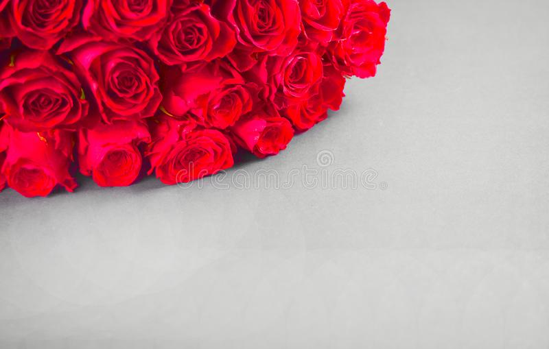 A bouquet of roses on the grey table. Copy space royalty free stock image