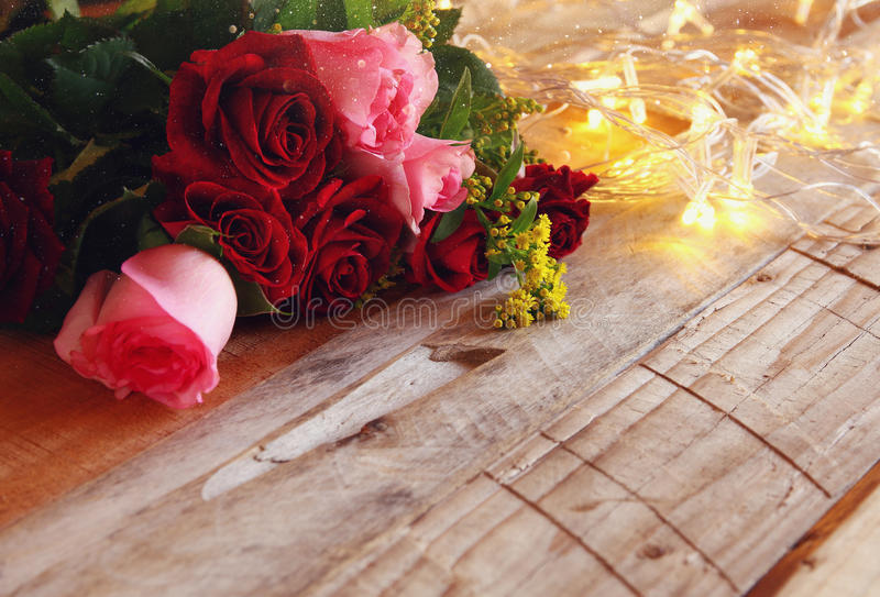 Download Bouquet Of Roses Next To Gold Garland Lights Stock Photo - Image: 83701071