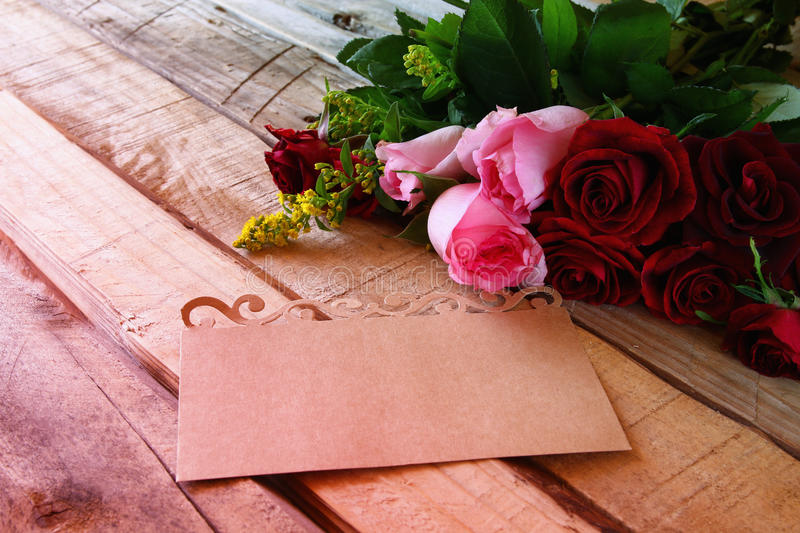 Download Bouquet Of Roses Next To Letter On Wooden Table Stock Image - Image of message, decor: 83701765