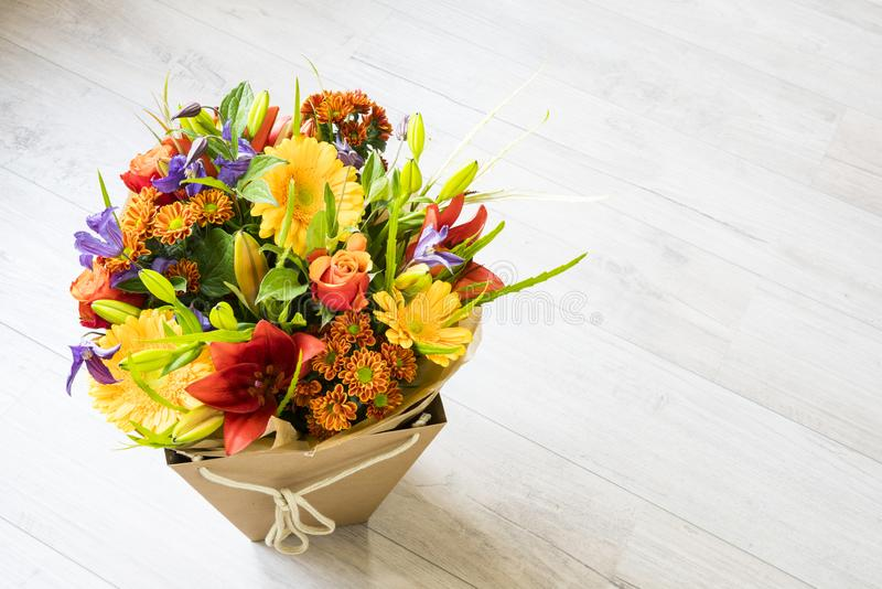 Bouquet with roses, red lily,  gerbera, dahlia and leaves. stock photography