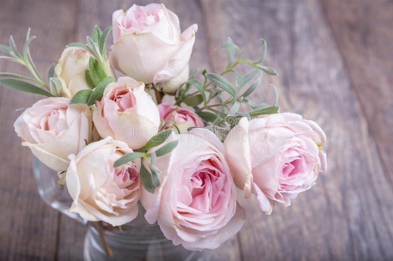 Bouquet of roses on wooden table. Gentle, romantic, beautiful bouquet of nostalgic white pink roses on a wooden table. Rose Madame Anisette. Birthday, Mother`s royalty free stock images
